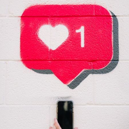 Heart social media icon with mobile phone